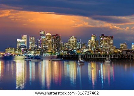 Boston downtown skyline panorama with skyscrapers over water at twilight USA - stock photo