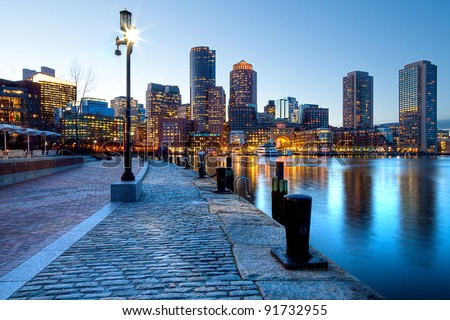 Boston Harbor and Financial District at sunset in Boston, Massachusetts. - stock photo