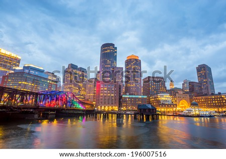 Boston Harbor and Financial District at twilight and Tea Party Ship Museum in Boston, Massachusetts. - stock photo