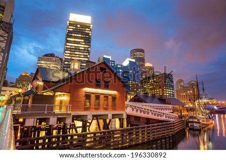 Boston Harbor and Financial District at twilight and Tea Party Ships & Museum in Boston, Massachusetts. - stock photo