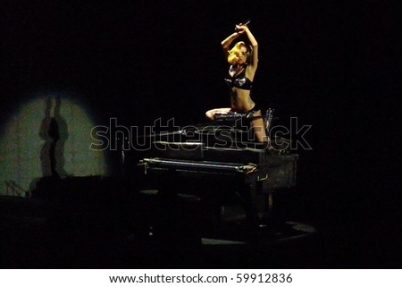 BOSTON- JULY 3 : Lady Gaga performs in the Monster Ball World Tour concert on July 3, 2010 in Boston, Massachusetts - stock photo