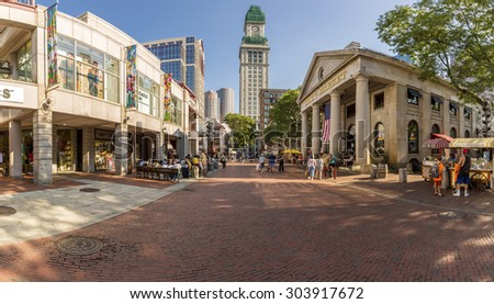 BOSTON, MA - AUGUST 3: Quincy Market in Boston, Massachusetts, USA with its mix of modern and historic architecture on a sunny summer day with lots os tourist passing by on August 3, 2015. - stock photo
