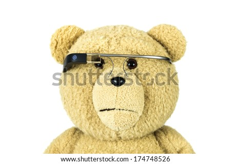BOSTON, MA, USA - JANUARY 31, 2014: A photo of a bear doll wearing Google Glass. Google Glass is a wearable computer with an optical head-mounted display that is being developed by Google - stock photo