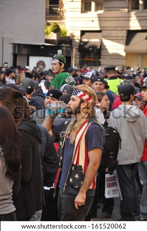 BOSTON, MASS.- 2 Nov: A patriotic fan at the Rolling Rally, held to celebrate the Boston Red Sox' World Series victory, in Boston on 2 November 2013.