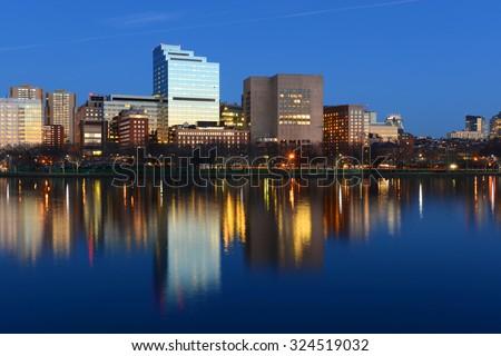 Boston Massachusetts General Hospital and West End Skyline at night, viewed from Cambridge, Boston, Massachusetts, USA - stock photo