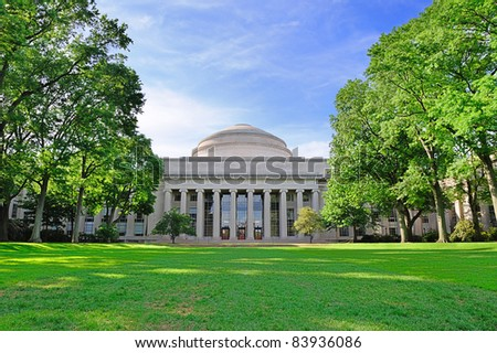 Boston Massachusetts Institute of Technology campus with trees and lawn - stock photo