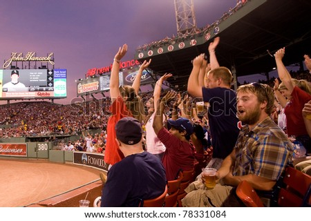 Boston - May 30: Fans cheer at historic Fenway Park during Memorial Day game against the Chicago White Sox May 30, 2011 in Boston, Massachusetts. - stock photo