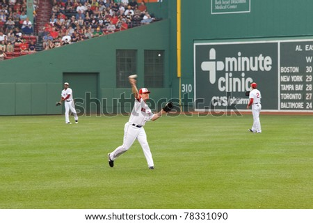 Boston - May 30: Red Sox right fielder #7 J.D. Drew warms up before Memorial Day game against the Red Sox on May 30, 2011 at Fenway Park in Boston, Massachusetts. - stock photo