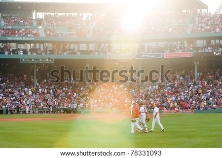 Boston - May 30: Starting pitcher Jon Lester and catcher Jarrod Saltalamacchia make their way to the field before Memorial Day game on May 30, 2011 at Fenway Park in Boston, Massachusetts. - stock photo