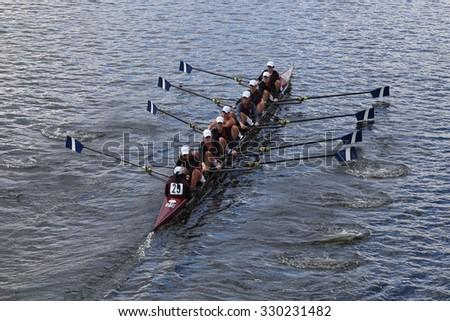 BOSTON - OCTOBER 18, 2015: Atlanta Junior Rowing races in the Head of Charles Regatta Women's Youth Eights - stock photo