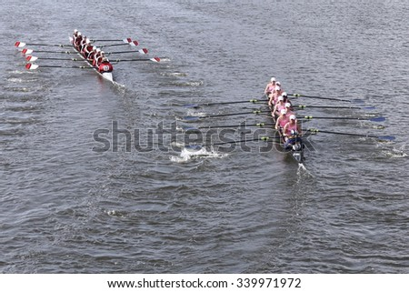 BOSTON - OCTOBER 18, 2015: Bedford (left) and Notre Dame Academy Rowing Club (right  races in the Head of Charles Regatta Women's Youth Eights [PUBLIC RACE] - stock photo