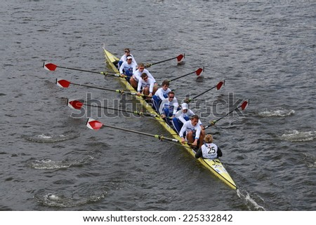 BOSTON - OCTOBER 19, 2014: Berlin University of Germany races in the Head of Charles Regatta Men's Championship Eights, Craftsbury Sculling Center won with a time of 14:20 - stock photo