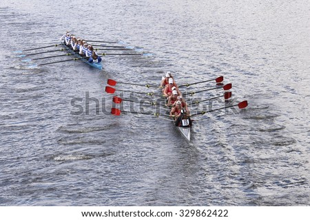 BOSTON - OCTOBER 18, 2015: Bromfield Acton Boxborough(left) and Hingham High School(right) races in the Head of Charles Regatta Women's Youth Eights [PUBLIC EVENT] - stock photo