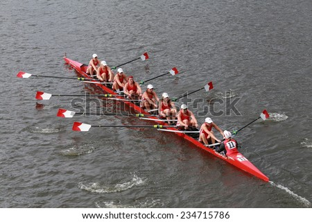 BOSTON - OCTOBER 19, 2014: Cornell University races in the Head of Charles Regatta Women's Championship Eights - stock photo