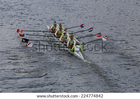 BOSTON - OCTOBER 19, 2014:  Craftsbury Sculling Center races in the Head of Charles Regatta Men's Championship Eights, they won with a time of 14:20