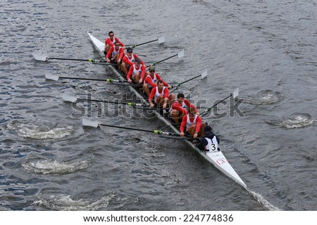 BOSTON - OCTOBER 19, 2014: French Rowing races in the Head of Charles Regatta Men's Championship Eights, Craftsbury Sculling Center won with a time of 14:20 - stock photo
