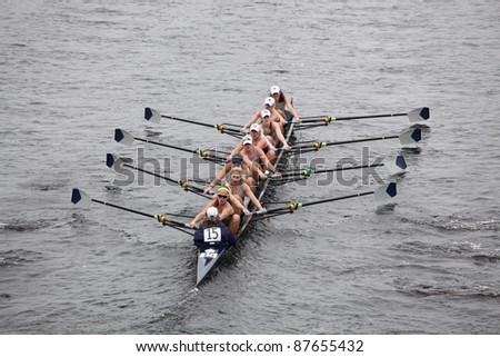 BOSTON - OCTOBER 23: Georgetown University women's Eights races in the Head of Charles Regatta.   Williams College won with a time of 14:17 on October 23, 2011 in Boston, MA. - stock photo
