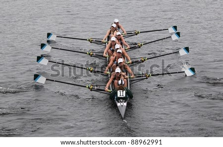 BOSTON - OCTOBER 23: Green Lake Crew youth womens Eights races in the Head of Charles Regatta. Oakland Strokes won with a time of 17:12 on October 23, 2011 in Boston, MA. - stock photo