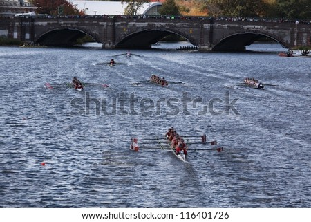 BOSTON - OCTOBER 21: Many teams race to go under the Anderson Bridge in the Head of Charles Regatta, Marin Rowing Association won with a with a time of 12:59 on October 21, 2012 in Boston, MA. - stock photo
