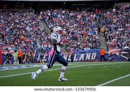 BOSTON - OCTOBER 16: New England Patriot returns kick at Gillette Stadium, New England Patriots vs. Dallas Cowboys on October 16, 2011 in Foxborough, Boston, MA - stock photo