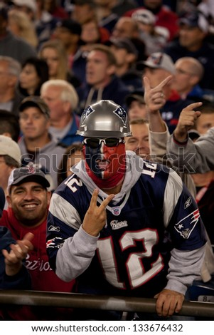 BOSTON - OCTOBER 16: New England Patriots fan showing v-sign at Gillette Stadium, New England Patriots vs. the Dallas Cowboys on October 16, 2011 in Foxborough, Boston, MA - stock photo