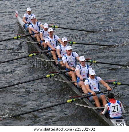 BOSTON - OCTOBER 19, 2014: Nicolaus Copernicus University of Poland races in the Head of Charles Regatta Men's Championship Eights, Craftsbury Sculling Center won with a time of 14:20 - stock photo