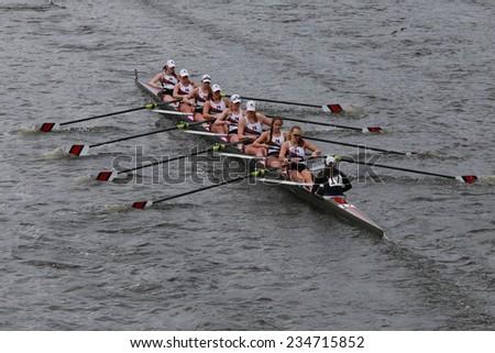 BOSTON - OCTOBER 19, 2014: Northeastern University races  in the Head of Charles Regatta Women's Championship Eights - stock photo