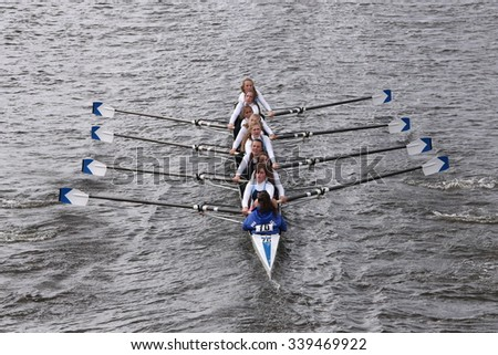 BOSTON - OCTOBER 18, 2015: Our Lady of Mercy  races in the Head of Charles Regatta Women's Youth Eights [PUBLIC RACE] - stock photo