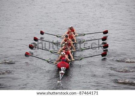 BOSTON - OCTOBER 23: Rutgers University races in the Head of Charles Regatta, Harvard University won with a with a time of 14:17 on October 23, 2011 in Boston, MA. - stock photo