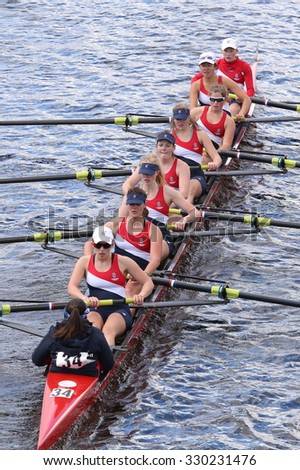 BOSTON - OCTOBER 18, 2015: Sammish Rowing Association races in the Head of Charles Regatta Women's Youth Eights - stock photo
