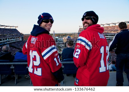 BOSTON - OCTOBER 16: Two New England Patriots football fans at Gillette Stadium, New England Patriots vs. the Dallas Cowboys on October 16, 2011 in Foxborough, Boston, MA - stock photo