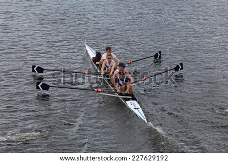 BOSTON - OCTOBER 19, 2014: Union Boat Club rowing races in the Head of Charles Regatta Men's Championship Fours - stock photo