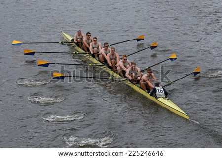 BOSTON - OCTOBER 19, 2014: Us Naval Academy Annapolis races in the Head of Charles Regatta Men's Championship Eights, Craftsbury Sculling Center won with a time of 14:20 - stock photo
