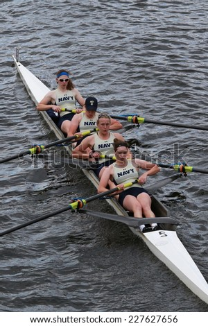 BOSTON - OCTOBER 19, 2014: US Naval Academy races in the Head of Charles Regatta women's Championship Fours - stock photo