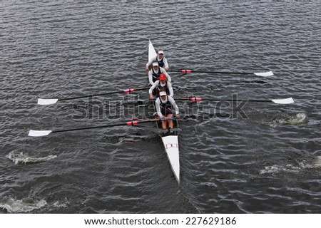 BOSTON - OCTOBER 19, 2014: US Rowing races in the Head of Charles Regatta women's Championship Fours - stock photo