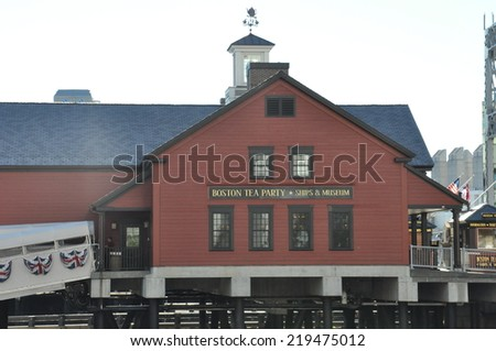 BOSTON - SEP 14: The Boston Tea Party Museum in Boston, Massachusetts, as seen on Sep 14, 2014. It is located on the Congress Street Bridge in Boston. - stock photo