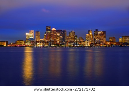 Boston skyline at sunset and river reflection in Massachusetts USA - stock photo