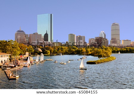 Boston skyline from Cambridge. Sailboats in Charles River, around the Esplanade - stock photo
