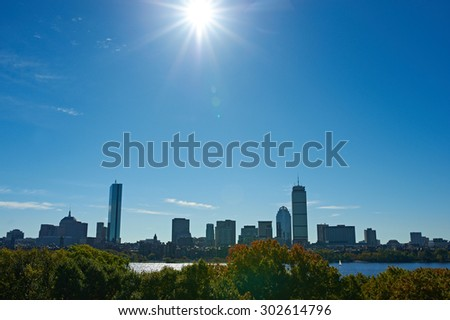 Boston skyline view with sun backlight from Cambridge at Massachusetts, USA - stock photo