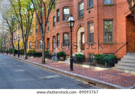 Boston townhouse. Brick apartment buildings and tree-lined street in Back Bay, Boston. Elegant streetscape.