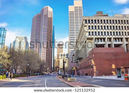 Boston, USA - April 29, 2015: Skyline with Skyscrapers in Congress Street and City Hall, downtown Boston, MA, USA. People on the background