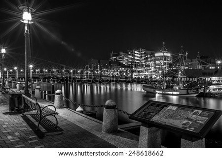 BOSTON, USA - JANUARY 10, 2015: Panoramic view of Boston at Night showcasing the architecture of its financial district on January 10, 2015. - stock photo
