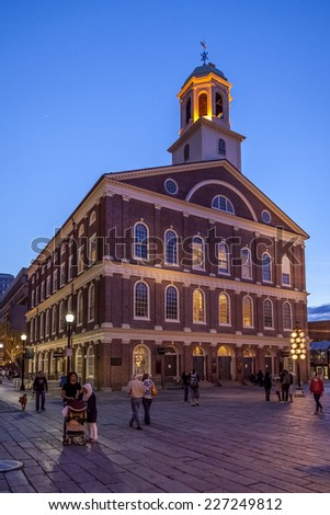 BOSTON, USA - JUNE 10: The famous Faneuil Hall in Boston, Massachusetts, USA at sunset with tourists and locals passing by on June 10, 2011 - stock photo