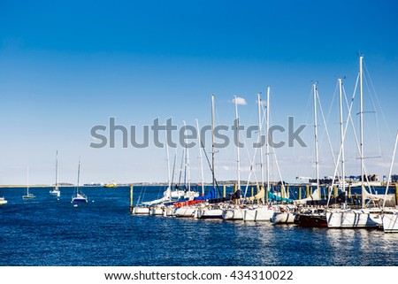 Boston, USA, spring-summer, Row of yachts at the harbor and Many luxury yachts park at the harbor with blue sky in boat lagoon  - stock photo