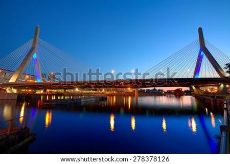 Boston Zakim bridge sunset in Bunker Hill Massachusetts USA - stock photo