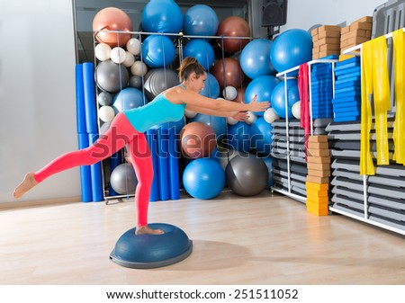 bosu one leg extension deadlift girl exercise at gym workout and swiss ball background - stock photo