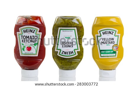 Bothell, Washington- May 31, 2015: Heinz products in squeezable plastic bottles consisting of Tomato ketchup, sweet relish, and yellow mustard. Isolated on white background with reflection in studio.  - stock photo