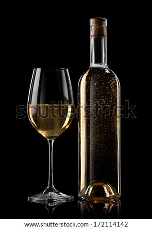 Bottle and glass of white wine on a black background - stock photo