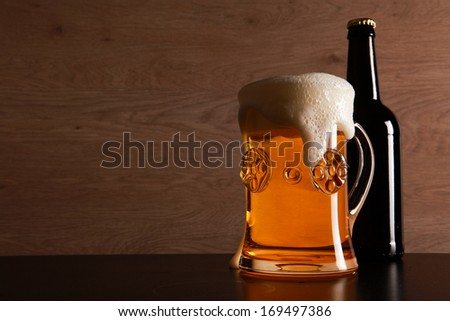 Bottle and glass with beer served on the table. - stock photo