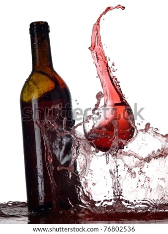 Bottle and glass with red wine splash - stock photo